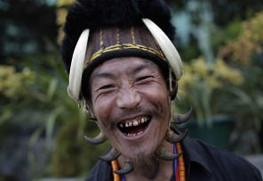A Naga dancer in traditional attire smiles at the camera during the opening day of the Hornbill festival at Kisama village on the outskirts of Kohima, Nagaland, India, Sunday, Dec.1, 2013. The 10-day long festival named after the Hornbill bird is one of the biggest festivals of India's northeast that showcases the rich tradition and cultural heritage of the indigenous Nagas. (AP Photo/Anupam Nath)