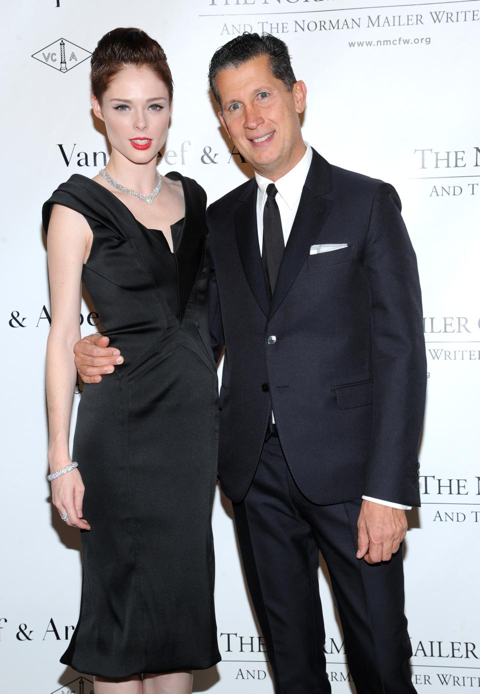 Model Coco Rocha, left, and Stefano Tonchi pose for photographers during the fifth annual Norman Mailer Center benefit gala at the New York Public Library on Thursday, Oct. 17, 2013, in New York. (Photo by Evan Agostini/Invision/AP)