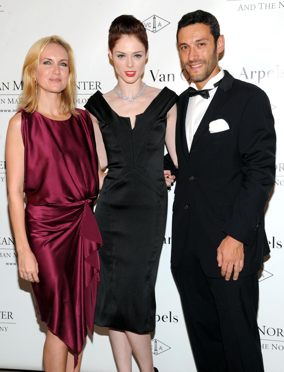 Kristina Buckley, left, Van Cleef & Arpels vice president of marketing and communications, Coco Rocha, center, and Alain Bernard pose for photographs during the fifth annual Norman Mailer Center benefit gala at the New York Public Library on Thursday, Oct. 17, 2013, in New York. (Photo by Evan Agostini/Invision/AP)