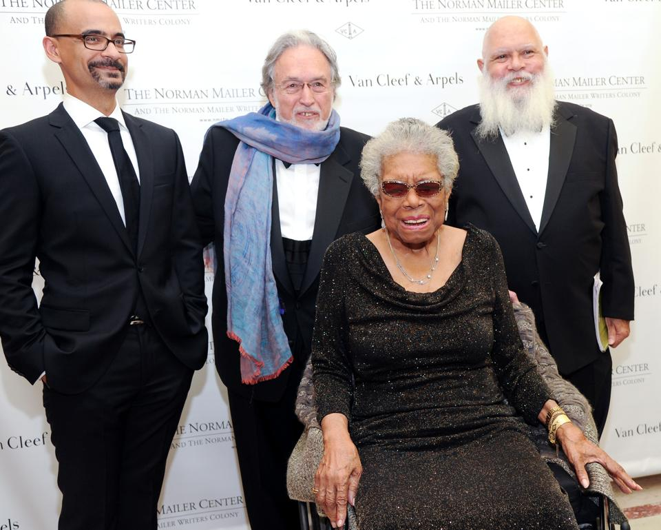 Maya Angelou, sitting, Junot Diaz, back left, Norman Mailer Center president and co-founder Lawrence Schiller, center, and Samuel R. Delany, right, pose for photographs during the fifth annual Norman Mailer Center benefit gala at the New York Public Library on Thursday, Oct. 17, 2013, in New York. (Photo by Evan Agostini/Invision/AP)
