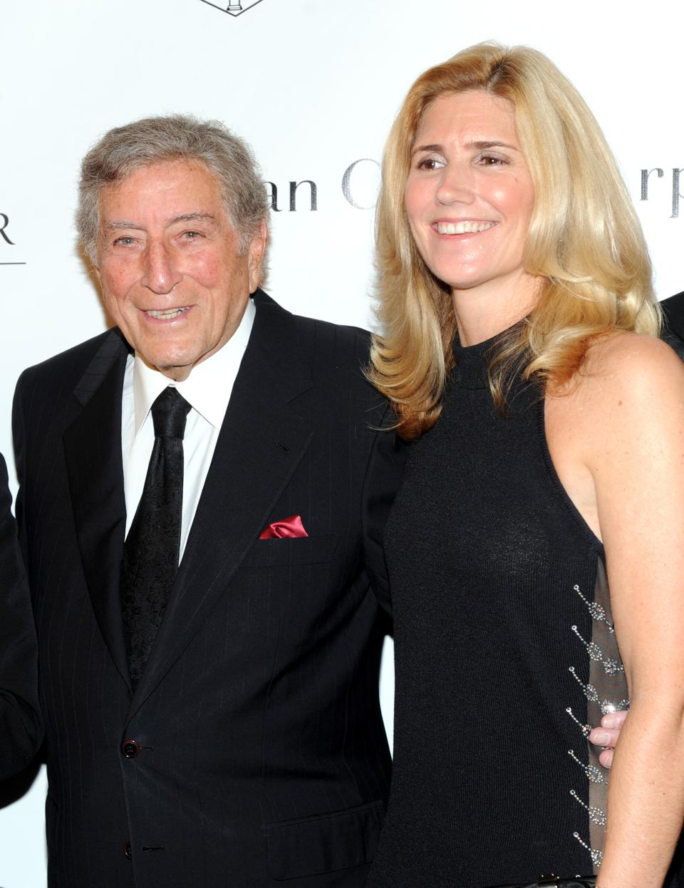 Singer Tony Bennett and his wife Susan Crow pose for photographs during the fifth annual Norman Mailer Center benefit gala at the New York Public Library on Thursday, Oct. 17, 2013, in New York. (Photo by Evan Agostini/Invision/AP)