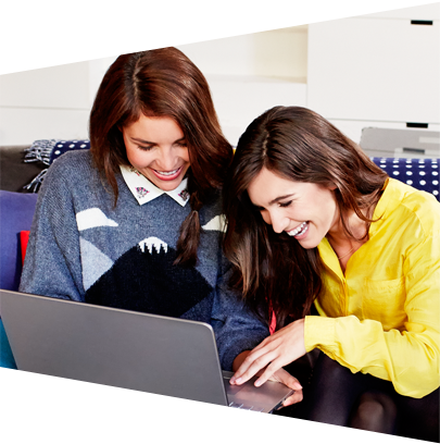 Two women sharing a laptop