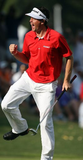 Original CKeegan Bradley celebrates his 35-foot birdie putt on No. 17 to tie Jason Dufner for the lead in the PGA. He went on to win in a three-hole playoff. (Jason Getz/AJC)