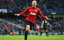 Wayne Rooney celebrates scoring for Manchester United against Manchester City