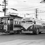 This historic image of a streetcar alongside a bus illustrates the scale of the two vehicles -- they're roughly the same. Despite the decades of changes since this picture was taken, streetcars and buses still remain relative equals in terms of height, width, and bulk. (Source: Oregon Live)