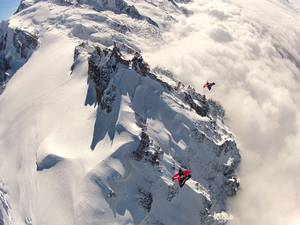 Espen Fadnes and Jokke Sommer descending to fly under the bridge at the top of Aiguille du Midi, 4,000m above Chamonix, France