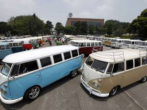 Various models of Volkswagen's Kombi minibus are displayed during a Kombi fan club meeting in Sao Bernardo do Campo, Brazil