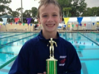 Boy, 9, wins 1st, gives trophy to rival