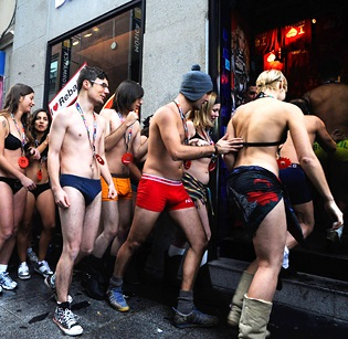 Shoppers in Spain Strip for Sales