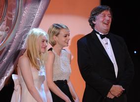 Dakota Fanning, Carey Mulligan and Stephen Fry on stage at the 2010 Britannia Awards.