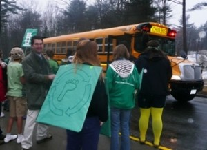 Each bus greeted by eTeam members to tally participants and give hand stamps