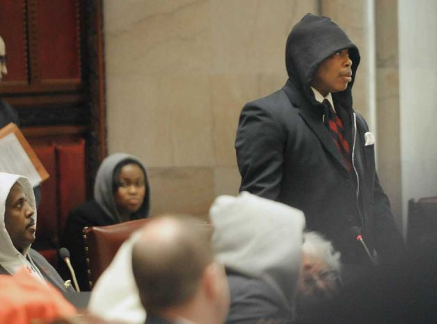 Senator Eric Adams wearing a hoodie under his suit jacket rises to address fellow members of the Senate during session at the capitol on Monday, March 26, 2012 in Albany, NY.  Some members of the Senate and the Assembly wore hoodies to show their outrage over the shooting of Trayvon Martin in Florida, who was wearing a hoodie when he was shot.    (Paul Buckowski / Times Union) Photo: Paul Buckowski