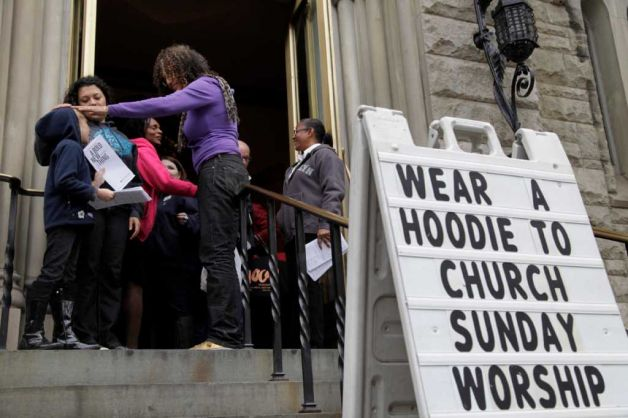 Congregants arrive at Middle Collegiate Church in New York, Sunday, March 25, 2012. Church-goers were invited to wear hoodies to services to show their support for justice in the case of Trayvon Martin, an unarmed black teenager who was wearing a hoodie on the night he was killed by a neighborhood watch captain in Florida. (AP Photo/Seth Wenig) Photo: Seth Wenig