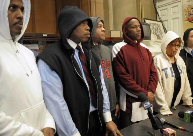 From left to righ, Senator Kevin Parker, Senator Eric Adams, Assemblyman Karim Camara,  Senator Bill Perkins and Senator Shirley  Huntley hold a press conference wearing hoodies at the capitol on Monday, March 26, 2012 in Albany, NY.  Some members of the Senate and the Assembly wore hoodies to show their outrage over the shooting of Trayvon Martin in Florida, who was wearing a hoodie when he was shot.    (Paul Buckowski / Times Union) Photo: Paul Buckowski