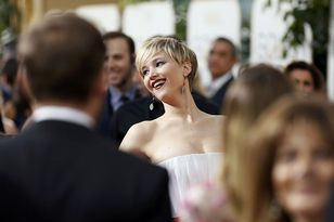 Jennifer Lawrence smiles on the red carpet at the 71st annual Golden Globe Awards in Beverly Hills