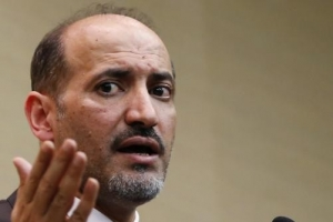 Syrian opposition leader Ahmed Jarba answers questions during a news conference in Geneva January 23, 2014.