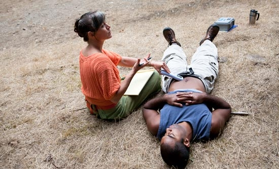 Doctor places device on student's stomach