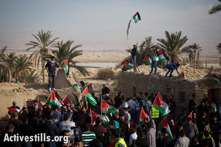 Palestinians shout slogans in the in Ein Hijleh protest village, in the Jordan Valley, West Bank January 31, 2014. Over 300 Palestinians participated in the action, as part of Melh Al-Ard (Salt of the Earth) campaign against the Israeli plans to annex the Jordan valley, discussed during the current round of negotiation-talks between the PA and Israel, coordinated by John Kerry.