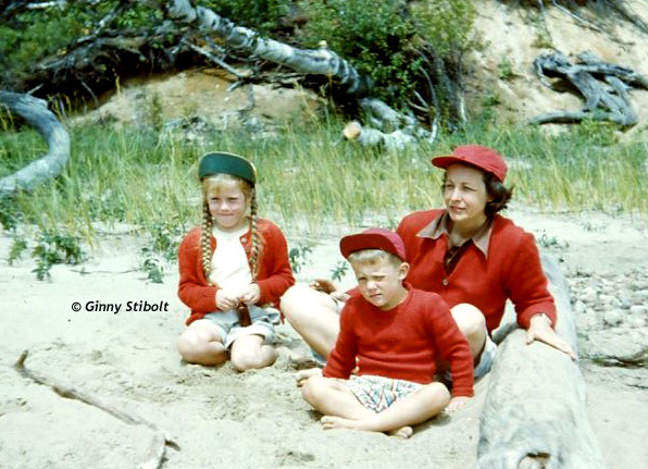 On the beach of the island in Long Lake. My mom took the time to coordinate our outfits. She loved red. Can you tell?