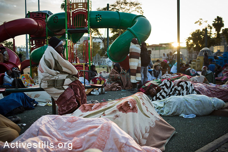 African asylum seekers wake up in Levinsky Park, South Tel Aviv, on the second day of sit-in, February 3, 2013. (photo: Oren Ziv/Activestills.org)