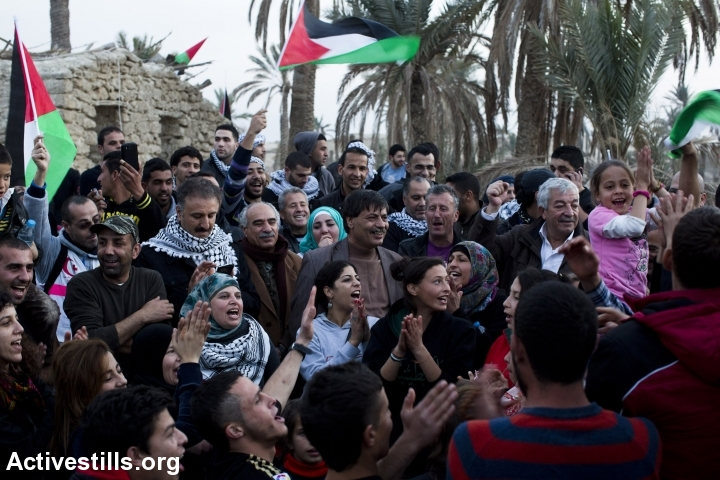 Palestinian activists celebrate as they arrive to Ein Hijleh protest village, in the Jordan Valley, West Bank January 31, 2014.