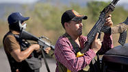 Mexico vigilantes backed by troops march into key city in Michoacan