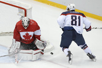 <p>USA&amp;nbsp;forward Phil Kessel shoots on Canada goaltender Carey Price during the first period of the men's semifinal ice&amp;nbsp;hockey&amp;nbsp;game at the 2014 Winter Olympics, Friday, Feb. 21, 2014, in Sochi, Russia. | &amp;nbsp;AP Photo/Mark Humphrey</p>