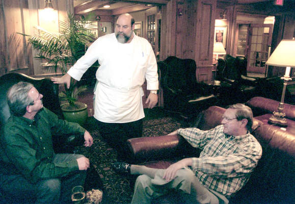 Jay Lovell, owner of Lovell's Restaurant in Lake Forest, talking in 2001 to customers Moe Iversont, left, and Roger Salway. The well-known restaurant is now up for sale. | FILE