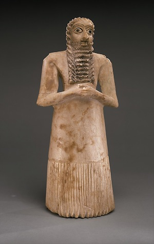 Standing Male Worshiper from Tell Asmar, Ancient Sumerian, c. 2900-2600 B.C.E., Gypsum alabaster, shell, black limestone, bitumen, 11 5/8 x 5 1/8 x 3 7/8 (Metropolitan Museum of Art)
