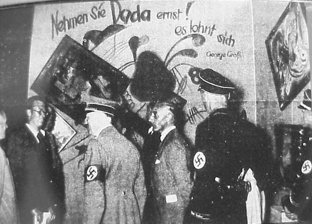 Adolf Hitler and Adolf Ziegler inspect the installation by Willrich and Hansen of the Degenerate Art Show, 1937