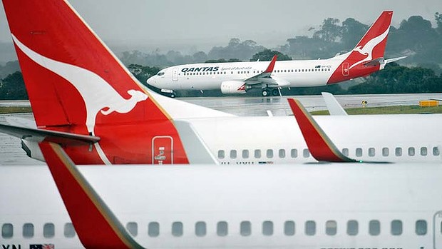 Generic Qantas pictures at Melbourne airport. Qantas announced they will reduce staff numbers by 1000 people. 5th of December 2013 The Age news Picture by JOE ARMAO