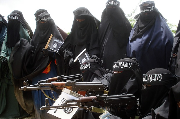 Somali women carry weapons during a demo