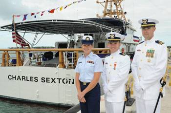File The cutter's command group, (left to right) Petty Officer 1st Class Nicole Thomas, first officer of the deck, Lt. j.g. Graham Sherman, executive officer, and Lt. Kevin Connell, commanding officer, were on hand to bring the ship to life. (U.S. Coast Guard photo by Sabrina Laberdesque)