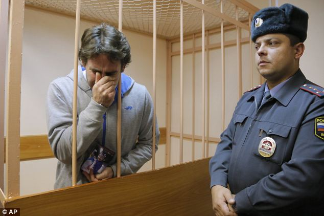 Emotion: Miguel Orsi of Argentina clutches a photograph of his daughter and sobs as he is told he has been granted bail after nearly two months inside a Russian jail after he was arrested during the protest in October