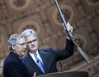 Sing-A-Long Mitch brings Gun to CPAC; Still doesn't get my support