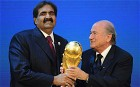HH Sheikh Hamad bin Khalifa Al Thani of Qatar receives the trophy from FIFA President Joseph S Blatter