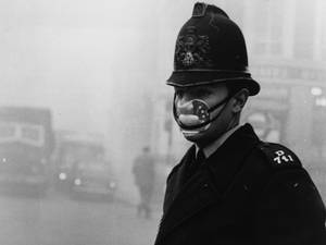 A London policeman wearing a mask for protection against the thick fog which hit most of the country and turned to smog in the city