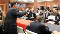 "Mayor Bill Peduto addresses Hilltop residents Monday during his ""Mayor's Night Out"" at the Warrington community recreation center in Beltzhoover."