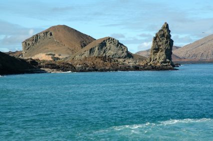 Pinnacle Rock is the eroded remains of a tuff cone. Isla Bartolome, Galapagos Islands, Ecuador. The Galapagos Islands are a UNESCO World Heritage Site.