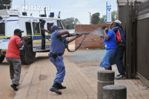 FILE PHOTO: Police fire rubber bullets at residents at point blank range, 13 March 2014, in Bekkersdal, Westonaria. Residents protested by blockading streets and pelting police cars over an election campaign planned by the ANC. Picture: Alaister Russell