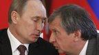 Russian President Vladimir Putin talks to Rosneft chairman Igor Sechin at the Kremline (2 July 2013)