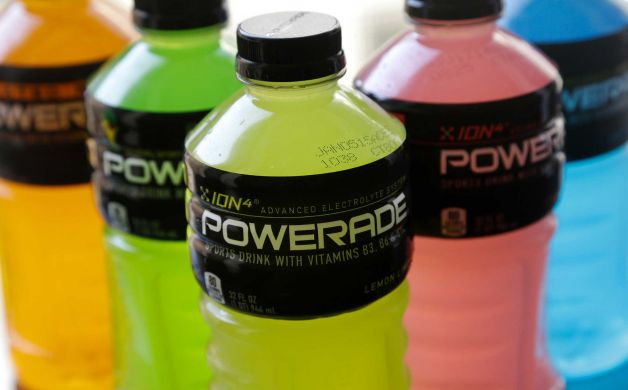 Powerade bottles in various flavors are photographed in San Francisco, Monday, May 5, 2014. A controversial ingredient, brominated vegetable oil, is being removed from some Powerade sports drinks. Photo: Jeff Chiu, AP / AP