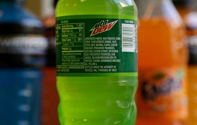 The ingredients on a bottle of Mountain Dew are photographed in San Francisco, Monday, May 5, 2014. Coca-Cola said on Monday it will drop brominated vegetable oil from all its drinks that contain it, not just Powerade. The Atlanta-based company says the controversial ingredient is still being used in some flavors of Fanta and Fresca, as well as several citrus-flavored fountain drinks. Photo: Jeff Chiu, AP / AP