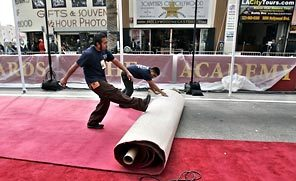 Workers roll out the red carpet in front of the Kodak Theatre in Los Angeles in preparation for Sunday's Academy Awards show.