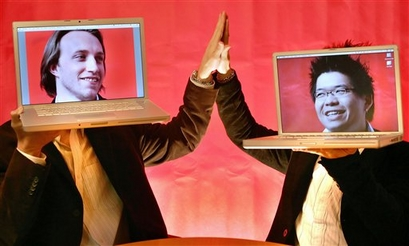 DECADE IN TECH - YouTube co-founders Chad Hurley, 29, left, and Steven Chen, 27, pose with their laptops at their office loft in San Mateo, Calif., in