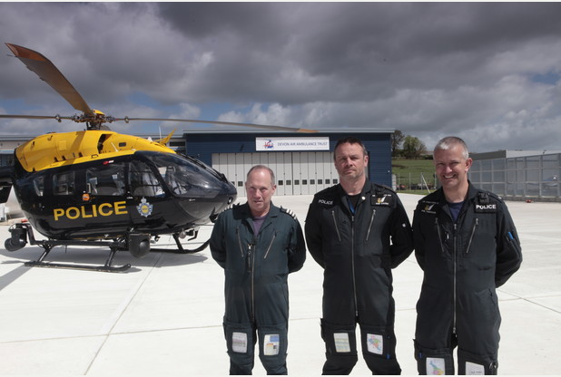 The police NPAS helicopter with (from left) Captain Ian Kingston and Tactical Flight Officers PC Rob Caught and PC Phil Knowles at the new airbase at Exeter Airport
