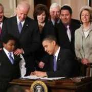 Obama signing Obamacare into law