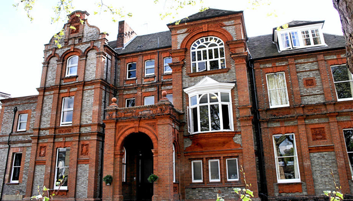 Exterior of the manor house that hostel Palmers Lodge Swiss Cottage is in