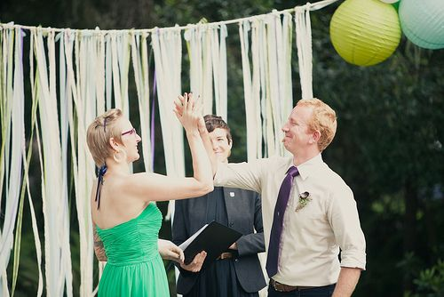 Erik and Shelley high five after getting married