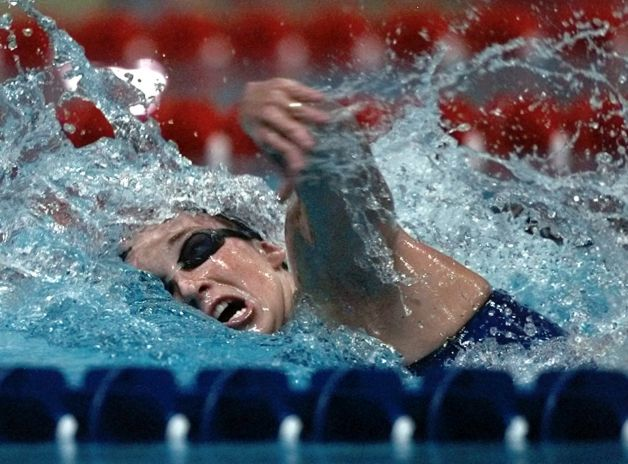 FILE - In this July 24, 1996 file photo, Amy Van Dyken of the United States swims her leg of the women's 4X100 meter medley relay at the 1996 Summer Olympics in Atlanta. Van Dyken has a severed spine after an accident on her all-terrain vehicle in Arizona. A hospital spokeswoman didn't provide details Monday on the injuries. The swimmer was hurt Friday night, June 6, 2014,  and told emergency workers at the scene she could not move her toes or feel anything touching her legs. (AP Photo/Denis Paquin, File) Photo: DENIS PAQUIN, Associated Press / AP